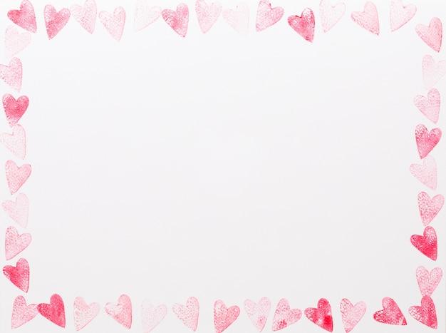 Cadre de coeur rouge et rose aquarelle abstraite