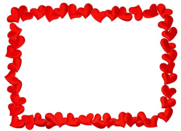 Cadre de coeurs rouges sur fond blanc. joyeuse saint valentin. symbole du 14 février.