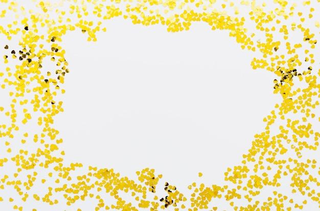 Cadre de confettis doré avec espace de copie