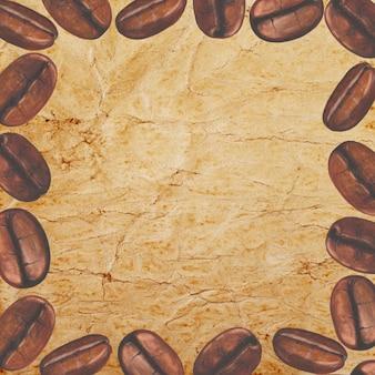 Cadre avec des grains de café torréfiés dessinés à la main à l'aquarelle sur une vieille surface de papier