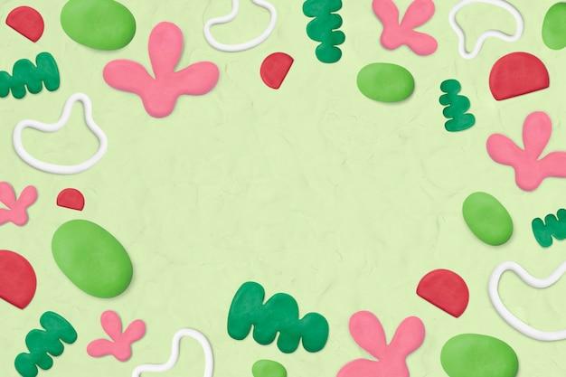 Cadre à motifs d'argile pour enfants sur fond vert texturé artisanat créatif pour enfants