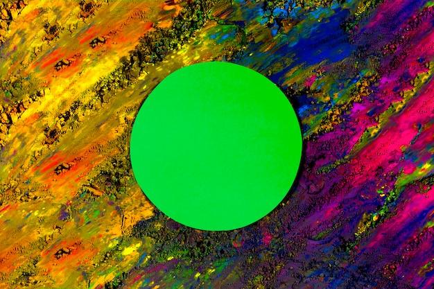 Cadre de papier cercle vert sur holi sec taché de couleur