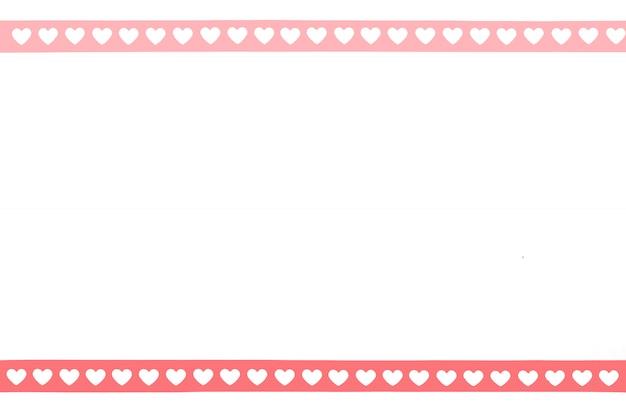 Cadre de papier rose en forme de coeur de la saint-valentin à l'ancienne bande de film 35mm