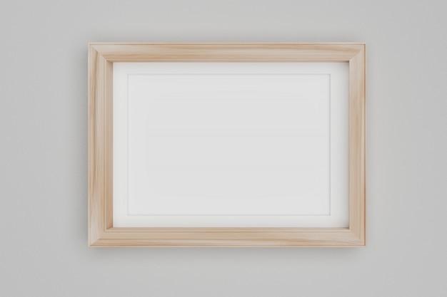 Cadre photo en bois blanc sur le mur