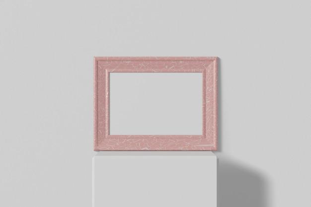 Cadre photo horizontal se dresse sur une étagère blanche