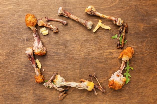 Cadre de restes de pilons de poulet