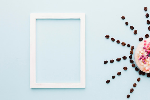 Cadre avec soleil de grains de café