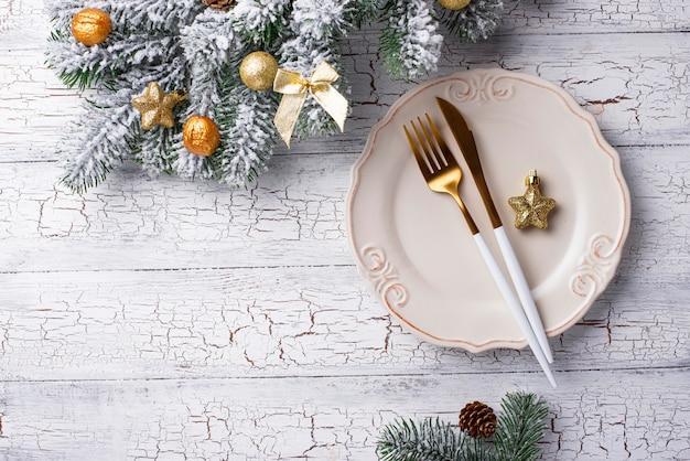 Cadre de table de noël et décor doré