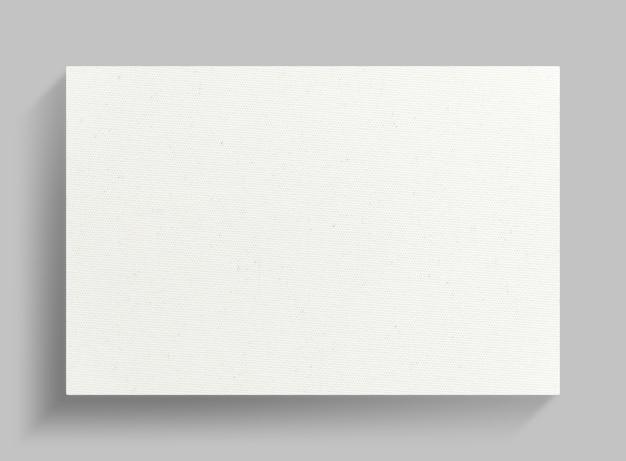 Cadre de toile blanche sur fond de mur gris.