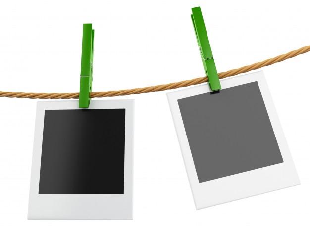Cadres photo 3d instantanés suspendus sur la corde à linge.