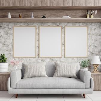Cadres photo sur le mur de marbre dans le salon avec un canapé au sol
