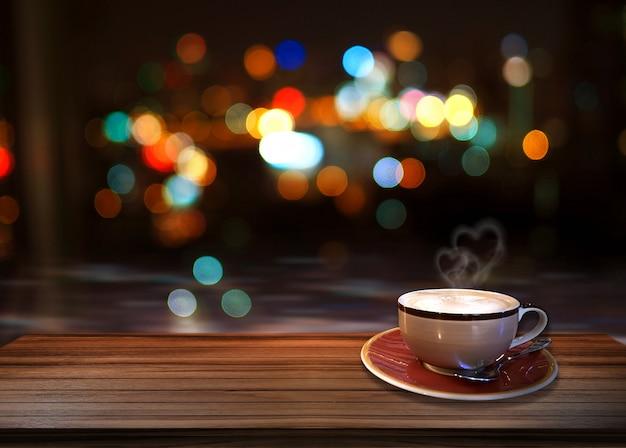 Café chaud avec fond fumée et coeur de bokeh.