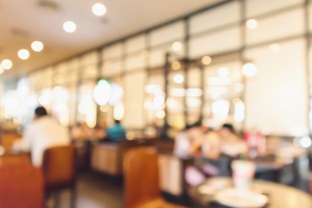 Café de restaurant ou intérieur de café avec des gens abstrait arrière-plan flou défocalisé