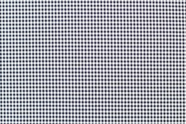 Cage noire et blanche en tissu. texture de tissu carré. fermer.