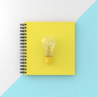 Cahier de couverture jaune avec ampoule sur fond pastel blanc et bleu.
