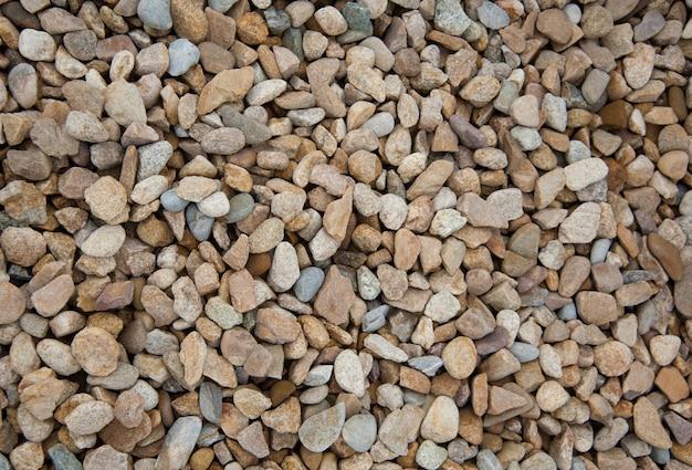 Cailloux de pierre fond de texture de gravier brun et gris pour la décoration.