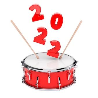 Caisse claire rouge avec paire de baguettes et signe du nouvel an 2022 sur fond blanc. rendu 3d