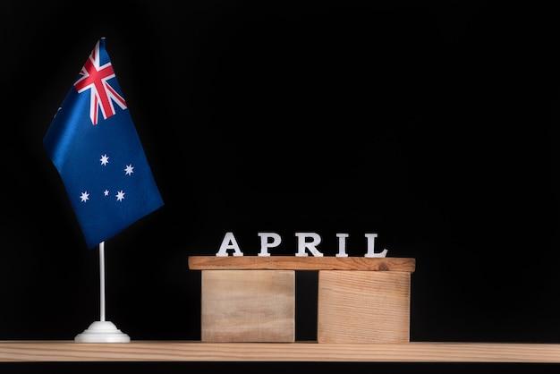 Calendrier en bois d'avril avec drapeau australien sur fond noir