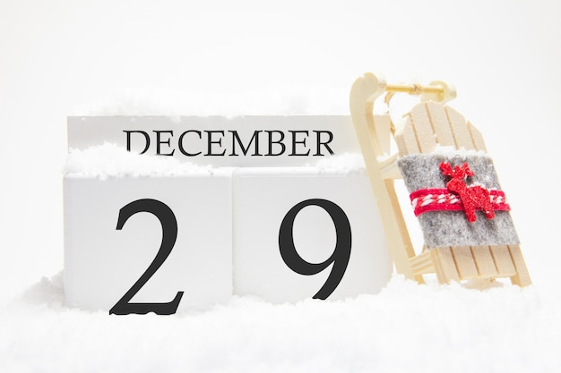 Calendrier en bois pour le 29 décembre, jour du mois d'hiver.