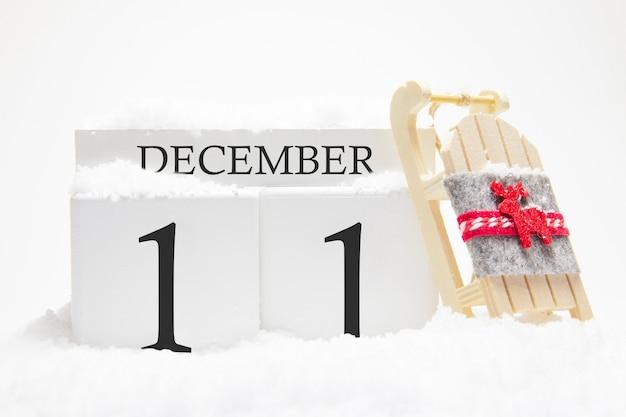 Calendrier en bois pour décembre, 11 ème jour du mois d'hiver.