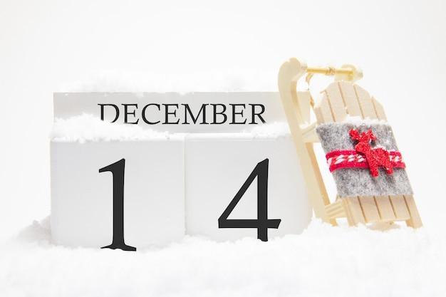 Calendrier en bois pour décembre, 14 ème jour du mois d'hiver.