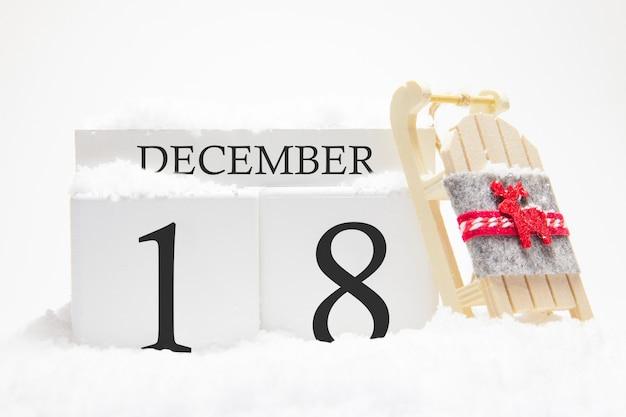 Calendrier en bois pour décembre, 18 e jour du mois d'hiver.