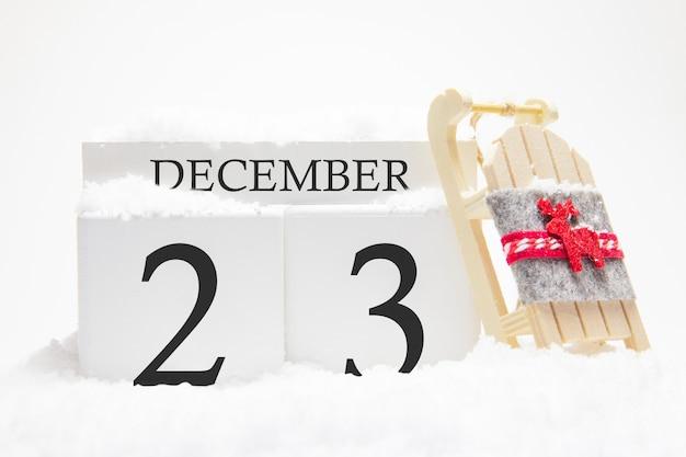 Calendrier en bois pour décembre, 23 e jour du mois d'hiver.