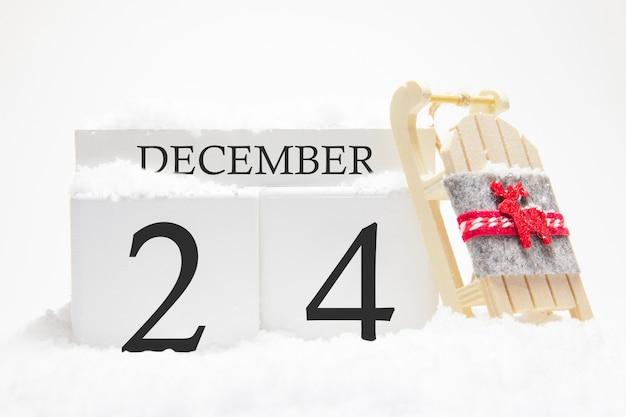 Calendrier en bois pour décembre, 24 e jour du mois d'hiver.