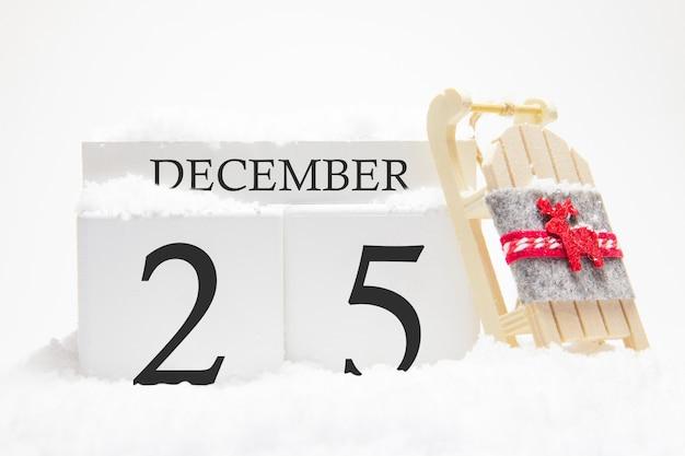 Calendrier en bois pour décembre, 25 e jour du mois d'hiver.