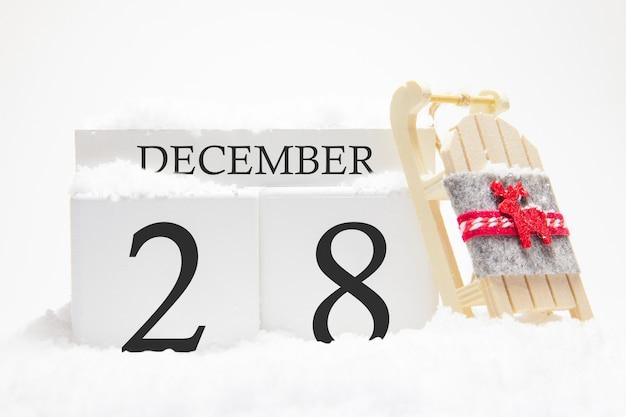 Calendrier en bois pour décembre, 28 e jour du mois d'hiver.