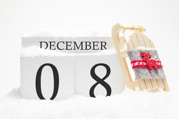Calendrier en bois pour décembre, 8 ème jour du mois d'hiver.