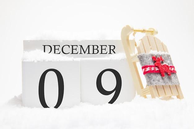 Calendrier en bois pour décembre, 9 ème jour du mois d'hiver.