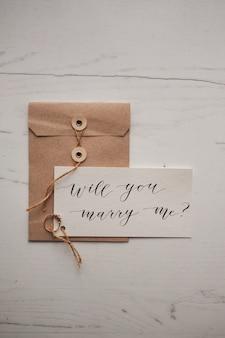 Calligraphie lettre design décoratif veux-tu m'épouser alliance