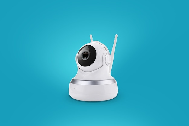 Caméra intelligente sans fil sur fond bleu. surveillance de la maison et des enfants via la connexion internet. protection numérique