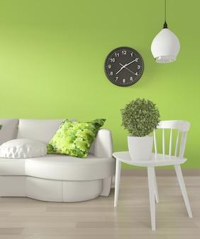 Canapé blanc et plantes de décoration sur mur vert clair et plancher en bois.
