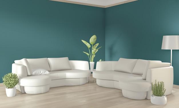 Canapé blanc et plantes de décoration sur mur vert foncé et plancher en bois.