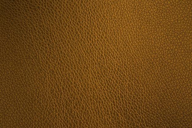 Canapé en cuir doré motif texture abstrait,