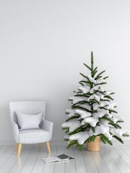 Canapé gris et arbre de noël en salle blanche