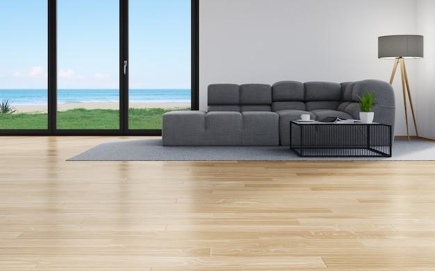 Canapé sur le parquet d'un salon dans une maison moderne avec vue ciel et mer