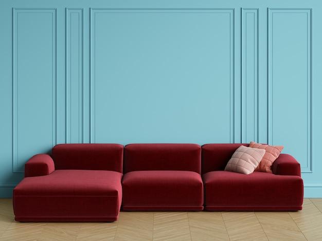 Canapé rouge design scandinave moderne à l'intérieur. murs bleus avec moulures, parquet à chevrons. espace copie, rendu 3d