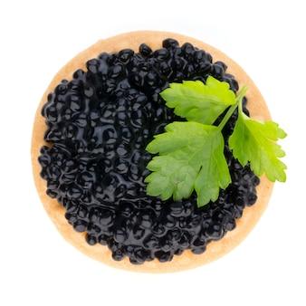 Canapés au caviar d'esturgeon noir et aux herbes