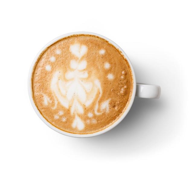 Cappuccino avec mousse mousseuse, vue de dessus de tasse de café gros plan sur une table en bois blanche. café et bar, concept d'art barista.