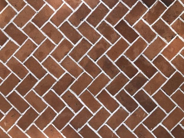 Capture en grand angle d'un trottoir en brique