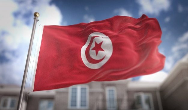 Carré de drapeau de la tunisie 3d sur fond de construction de ciel bleu