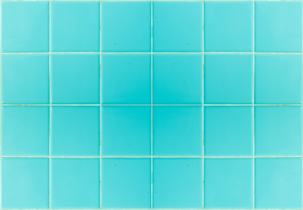 Carreau bleu gros plan dans la texture de mur de salle de bain