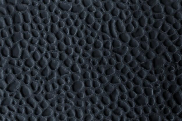 Carreau de céramique avec relief en noir