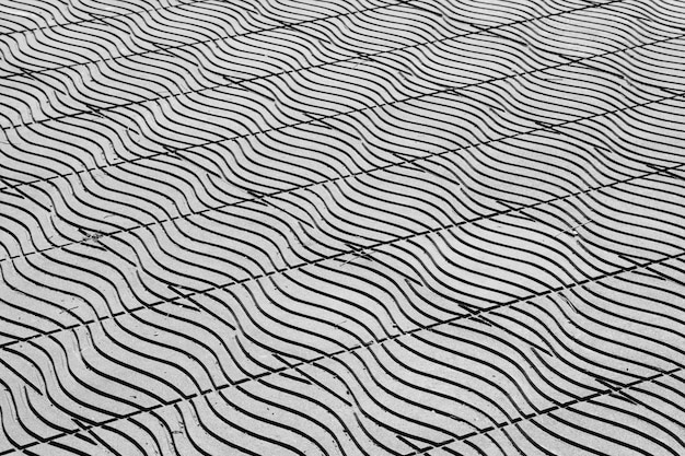 Carreaux de sol en fond de rue de ville urbaine - monochrome