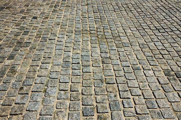 Carreaux texturés au sol de la rue en arrière-plan