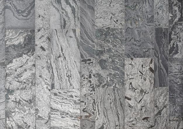 Carrelage en marbre noir avec de nombreux effets rayés