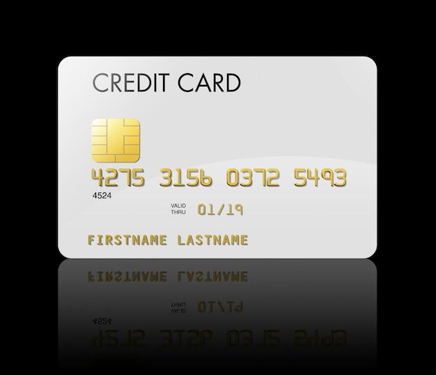 Carte de crédit blanche isolée sur fond noir avec un tracé de détourage